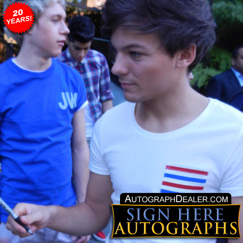 One Direction in-person autographed photo by all 5